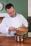 Cocinero y zanahoria Fotografía de archivo libre de regalías