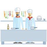 Cocineros en cocina Fotos de archivo libres de regalías