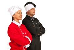 Cocineros felices del equipo que miran al futuro Imágenes de archivo libres de regalías