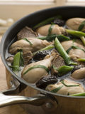 A leekie in a saucepan. A leekie in a black saucepan stock photos