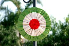 Cockade with the colors of the Italian flag. Red, white and green cockade (roundel) representing the Italian flag Royalty Free Stock Photos