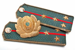Cockarde and epaulets of the Soviet militia Stock Photography