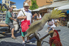 Cockatoo and parrot in the old town of rhodes Royalty Free Stock Images