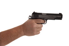 Cocked and loaded. Handgun cocked in a hand with finger on the trigger isolated on white Stock Photos