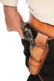 A cocked pistol pulled out of a leather holster Royalty Free Stock Images