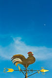 A cockerel wind vane. Against blue sky stock image