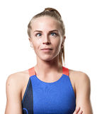 Cockeyed Blue eyed blond girl. With tail hair in sportswear with crossed arms front standing on white isolated background Royalty Free Stock Photos