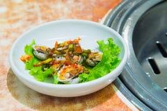 Cockle served with kimchi sauce mixed vegetable call. Kkomakjim Stock Image