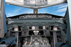 Cockpit. Of an airliner with a great blue sky ahead Stock Photo