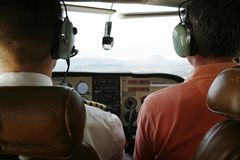 Cockpit. Pilot and passenger in cockpit of small plane. Focus is on the two people Stock Photos