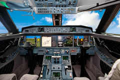 The cockpit of the aircraft. With blue sky outside stock photo