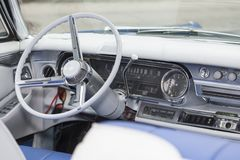 Cockpit of an american veteran automobile with ivory steering wheel and gear shirt royalty free stock images