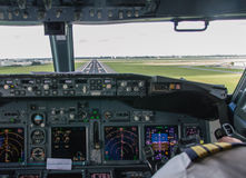 Cockpit Approach. Cockpit view of an airline pilot about to land on final approach royalty free stock image