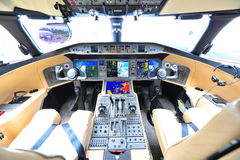Cockpit of Bombardier Global 6000 executive jet at Singapore Airshow. SINGAPORE - FEBRUARY 12: Cockpit of Bombardier Global 6000 executive jet at Singapore Stock Images