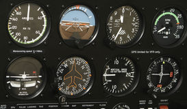 Cockpit Control Panel. A control panel in a small airplane is filled with indicators and various controls Royalty Free Stock Photos