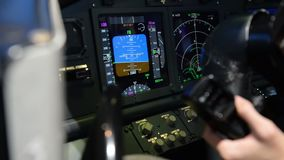 Cockpit display panel while aircraft turn left.  stock footage