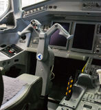Cockpit of Embraer 175. Close up of joystick of cockpit (cloches Royalty Free Stock Image