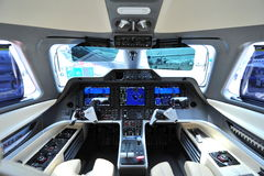 Cockpit of an Embraer Phenom 300 business jet at Singapore Airshow Royalty Free Stock Images