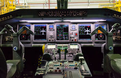 Cockpit of Embraer. Sophisticated cockpit of an airplane horizontal view, night view Royalty Free Stock Photos
