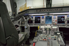 Cockpit of Embraer. Sophisticated cockpit of an airplane horizontal view, night view Royalty Free Stock Image