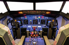 Cockpit of an homemade Flight Simulator - Boeing 737/800. Inside a flight simulator with all lights on, ready for take off Stock Photo