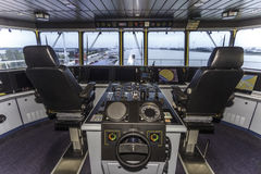 Cockpit of a huge container ship. View of the captain and copilot seats in the cockpit of a container ship parking at Rotterdam seaport Royalty Free Stock Photos