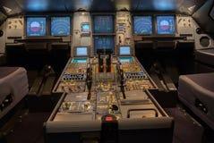 Cockpit. Modern jet airplane cockpit illuminated Stock Photo