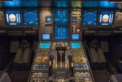 Cockpit. Modern jet airplane cockpit illuminated Stock Image