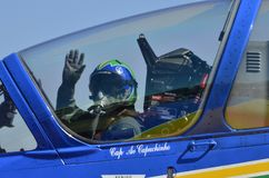Cockpit pilot waving close-up minutes before takeoff royalty free stock photography