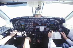 The cockpit and the pilots in a commuter airplane Royalty Free Stock Images