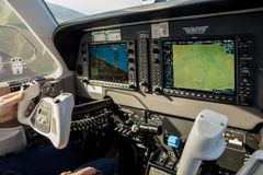 Cockpit of small, sport aircraft. A view of a glass cockpit dashboard and knap.  Royalty Free Stock Photography