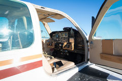 Cockpit of small white propeller aircraft plane Stock Photo