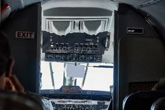 Cockpit view of Beechcraft 1900D in flight from passanger seat stock photography