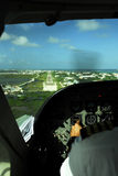Cockpit view of plane landing in belize. Pilot landing plane in belize Stock Image