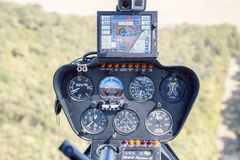 Cockpit view of Robinson R44 helicopter. DOBANOVCI, SERBIA - AUGUST 26, 2017: Cockpit view of Robinson R44 helicopter during flying, operated by Balkan Stock Photo