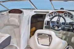 Cockpit of yacht from wood and leather royalty free stock photography