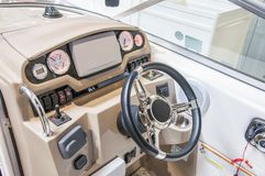 Cockpit of yacht from wood and leather stock photos