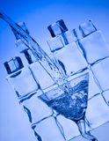 Cocktail. Splashing cocktail. Blue beverage and ice Stock Photo