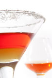 Cocktail. With red and yellow layers and cognac Royalty Free Stock Image