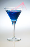 Cocktail. Close up shot of a blue cocktail with pink straws Royalty Free Stock Photo