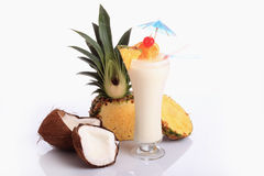 Cocktail. Pina Colada over white background, garnished with slice of pineapple and orange Royalty Free Stock Images