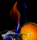Cocktail. With flame on the black background Stock Images