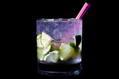 Cocktail. A Caipirinha (Brazilian cocktail) over black background Royalty Free Stock Image