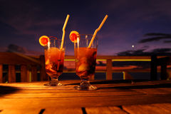 Cocktail. By sunset on wooden table Stock Photo