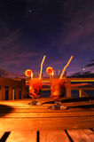 Cocktail. By sunset on wooden table Stock Images