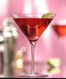 Cocktail. With lime, pink background stock photo