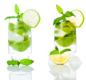 Cocktail. Mojito cocktail  with lemon and mint isolated on white background Stock Photos
