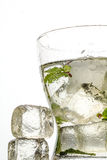Cocktail. Mojito cocktail with ice lemon and mint Royalty Free Stock Images