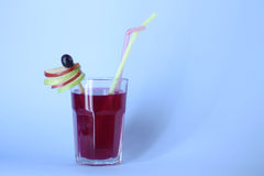 Cocktail. Red cocktail with straw and decoration Stock Images