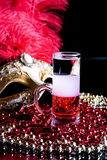 Cocktail. And Venetian mask on a black background Royalty Free Stock Photos